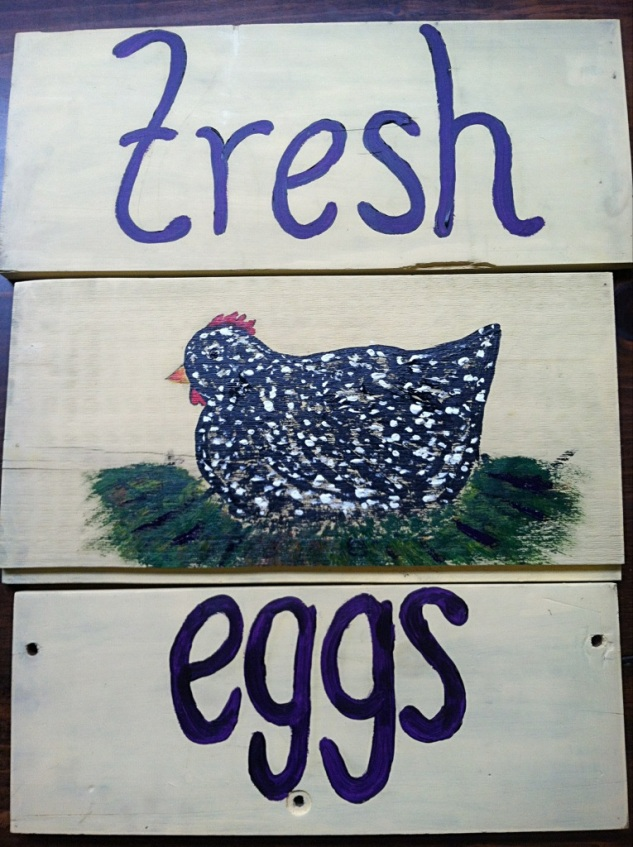 Fresh Eggs sign boasts a Barred Rock on one side, a Rhode Island Red on the other.